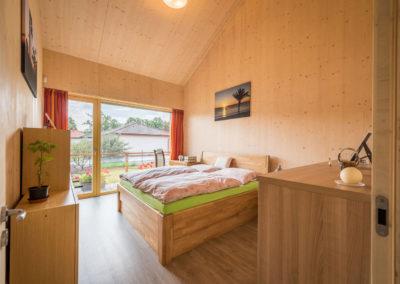Ložnice v rodinné dřevostavbě u Ostravy